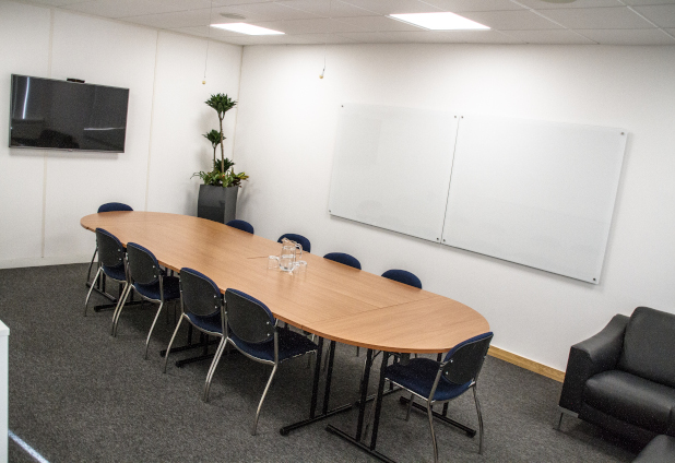 The Rawlings Room, which is our smaller meeting room, comfortably accommodates either 12 people in a boardroom style setup, or 35 people theatre style.
