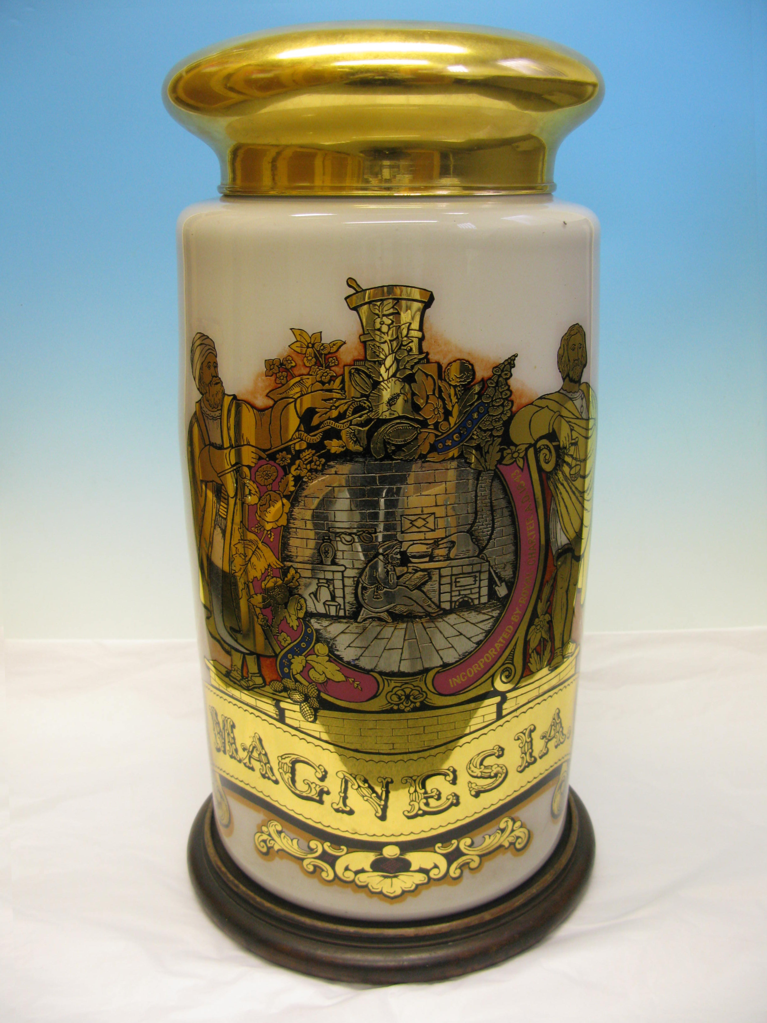 LDRPS: LSA7, 19th Century. This gold and white specie jar would have been used for decoration, rather than to store materials. The Jar is decorated with the coat of arms of the Pharmaceutical Society